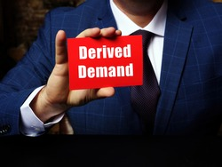Financial concept about Derived Demand with sign on blank business card.