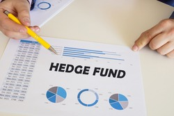 Financial concept about HEDGE FUND with sign on the chart sheet.