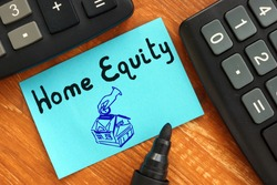 Financial concept about Home Equity with sign on the sheet.