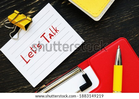 Financial concept about Let's Talk  with inscription on the sheet. Stock fotó ©