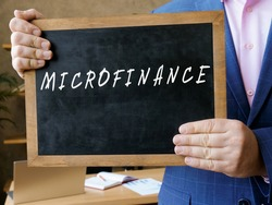 Financial concept about MICROFINANCE with inscription on the board