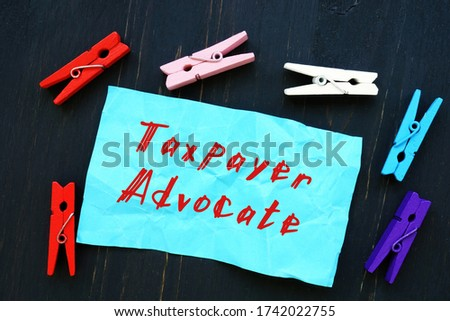 Financial concept about Taxpayer Advocate with sign on the sheet. Stock photo ©