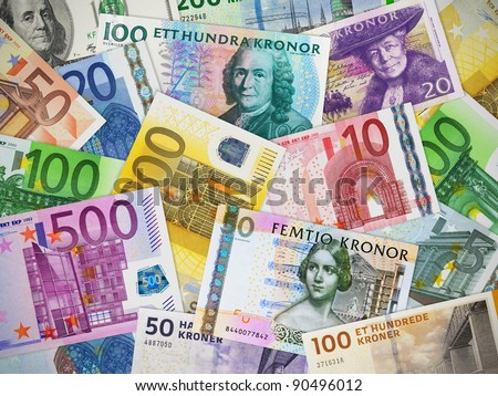 Financial concept: big collection of different paper currencies: Euro, US dollar, Swedish krona and Danish krone