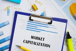 Financial concept meaning Market Capitalization with phrase on the piece of paper.