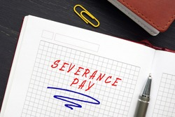 Financial concept meaning SEVERANCE PAY with sign on the page. Severance pay is the compensation and benefits an employer provides to an employee after employment is over