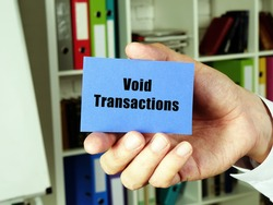 Financial concept meaning Void Transactions with phrase on the blue business card.