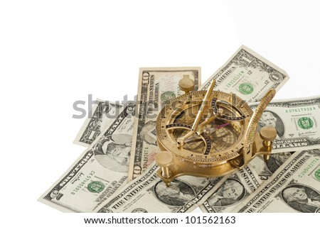 Financial concept. Old brass navigation sextant on dollar bills. Including clipping path.