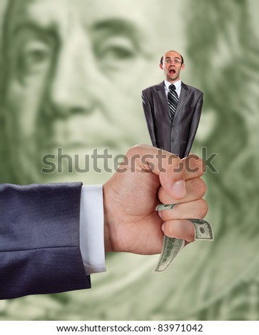 financial crisis concept - hand squeezing businessman full of money