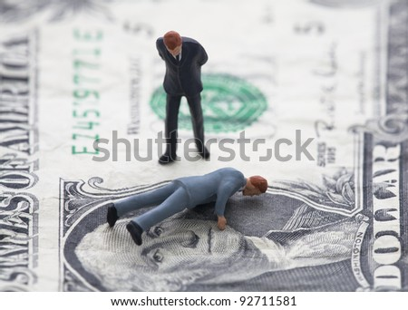 Financial crisis. Figure of businessman on one dollar bill