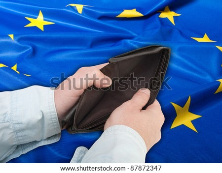 Financial Crisis  - Man's Hand With Empty Wallet and Flag of European Union