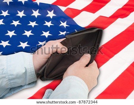 Financial Crisis  - Man's Hand With Empty Wallet and Flag of USA