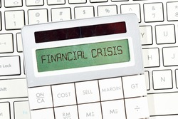 FINANCIAL CRISIS text on the calculator screen. Concept in business.