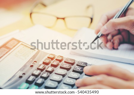 financial data analyzing hand...