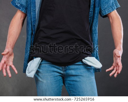 Financial difficulties, bad economy, no money concept. Young man student boy showing empty pockets, part of body male hips wearing jeans pants Stock photo ©