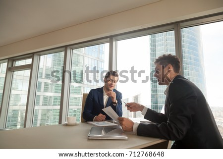 Financial director explaining business plan, telling about economical results, presenting attractive investment project to company owner. Consultant notifying client about positive dynamics of incomes