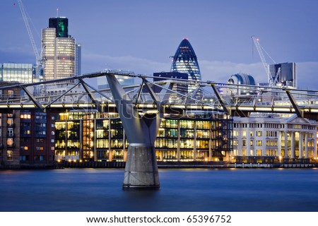 Financial District and Millennium Bridge, London. This view includes :Tower 42 Gherkin,Willis Building, and Stock Exchange Tower