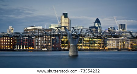 Financial District and Millennium Bridge, London. This view includes :Tower 42 Gherkin,Willis Building, and Stock Exchange Tower and Millennium Bridge.