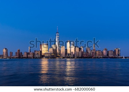 Financial District skyscrapers and Hudson River at dusk. Lower Manhattan, New York City #682000060
