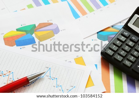Financial documents with red pen and calculator