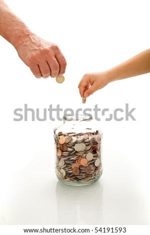 Financial education concept with senior and child hands putting coins in a jar - isolated