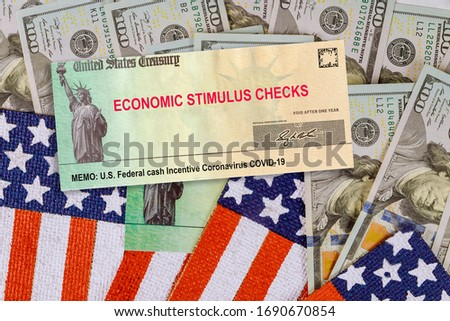 Financial Federal STIMULUS Coronavirus Global pandemic Covid 19 lockdown financial relief checks from government US 100 dollar bills currency on American flag Photo stock ©