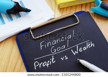 Financial Goal - Profit vs Wealth free form on the desk. #1505244800