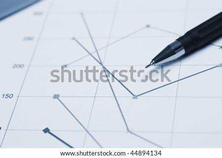 Financial graph and a pen macro photo - stock photo