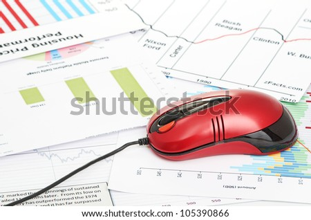 financial graph chart with red computer mouse