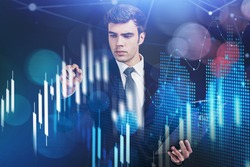 Financial graph showing increase of price in stock market, internet trading concept, Handsome trader touching chart. Forex. Double exposure