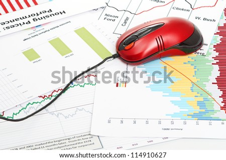 financial graph with computer mouse - stock photo