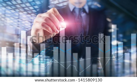 Financial graphs and charts on blurred business center background. Invesment and trading concept. #1415809130