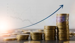 Financial growth concept. Stacks of gold coins on table and raising arrow over economic charts and diagrams on background, creative collage for business success or profit achievement, copy space