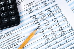 Financial income statement with calculator and pencil. Balance the investment portfolio