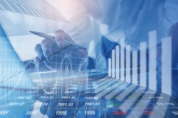 Financial investment, business analysis concept. Double exposure of businessman and stock market or forex graph. Economy trends background. Finance background for business design or presentation.