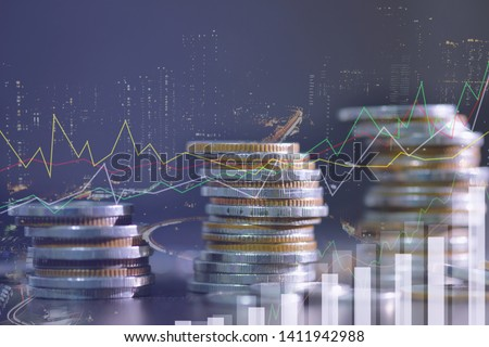 Financial investment concept, Double exposure of city night and stack of coins for finance investor, Forex trading candlestick chart economic , ECN Digital economy, best, technology, Industry, money.