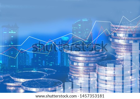 Financial investment concept, Double exposure of city night and stack of coins for finance investor, Forex trading candlestick chart economic , ECN Digital economy, business, money, passive income.