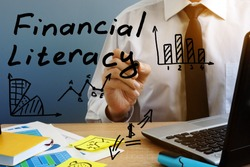 Financial Literacy. Man at the office table.
