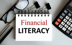 financial literacy, text on white paper on gray background