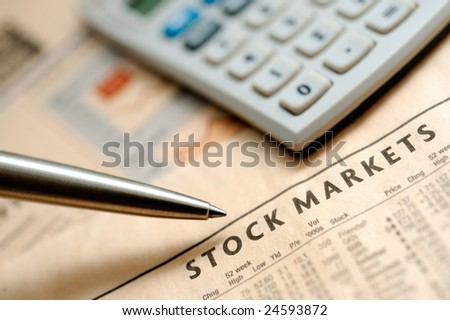 Financial newspaper and calculator