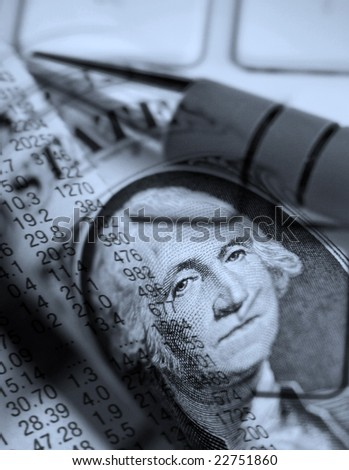 Financial newspaper on laptop overlaid with dollar abstract