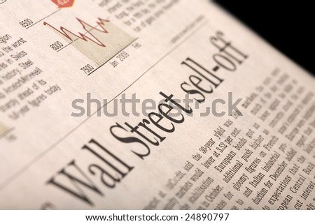 "Financial newspaper page with headline ""Wall Street sell-off"" - perspective view with shallow depth of field."