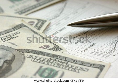 Financial newspaper, US  dollars and pen