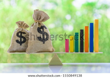 Financial objectives for sustainable growth concept : US dolar bags, rising bar graphs on a basic balance scale, depicts managing portfolio by investing in long-term securitized assets and mutual fund