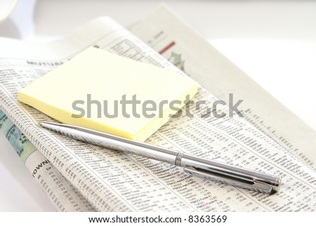 Financial or economy concept with newspaper, pen, and notepad