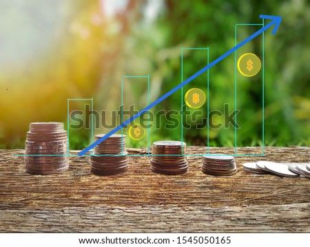 Financial planning concepts  With a status bar graph  Economic business.   coin placed on the floor with a natural bokeh background.