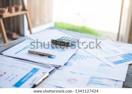 financial planning working calculating and analyzing financial data at home office Business and office concept. #1341127424