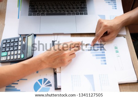 financial planning working calculating and analyzing graph documents at modern office Business and office concept. #1341127505