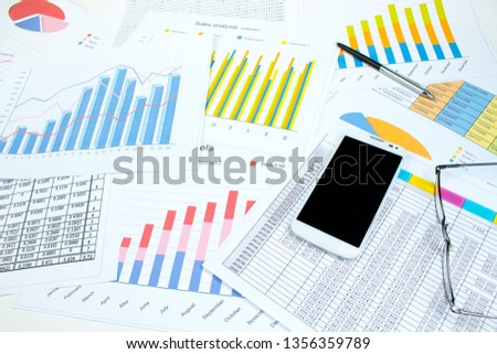 Financial printed paper charts, graphs and diagrams on the table #1356359789