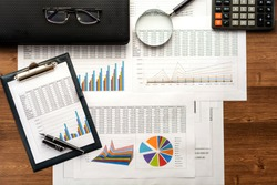 Financial printed paper charts, graphs,calculations, calculator  and diagrams