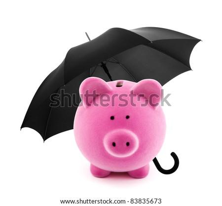 Financial protection. Piggy bank with umbrella